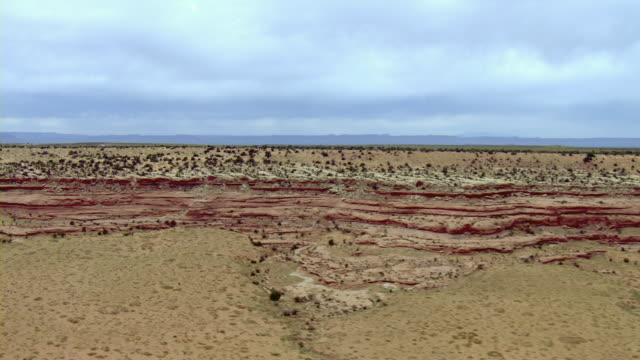 Layers of rock form a ledge in the vast Utah desert.