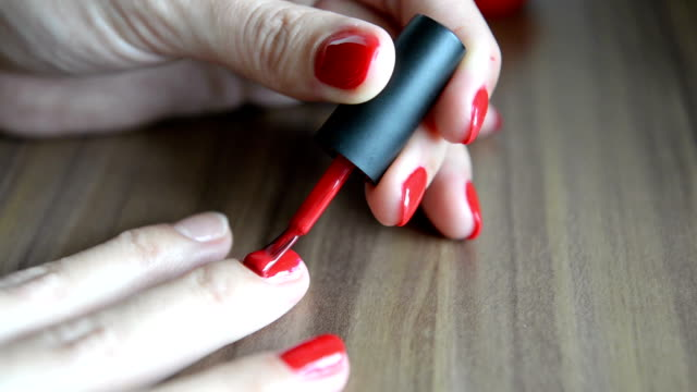 laying nail polish - red nail polish stock videos and b-roll footage