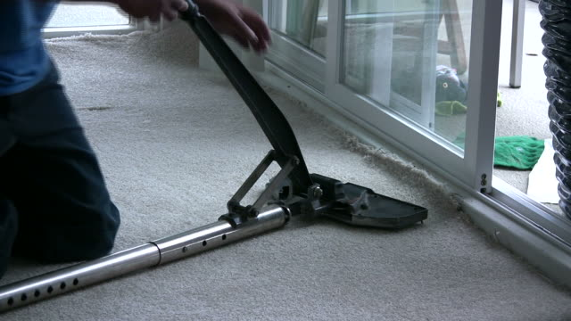 (hd1080i) laying new carpet, stretching to fit floor - installing stock videos & royalty-free footage