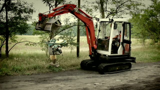 laying of a high-speed internet cable - underground engineering - one mid adult man only stock videos & royalty-free footage