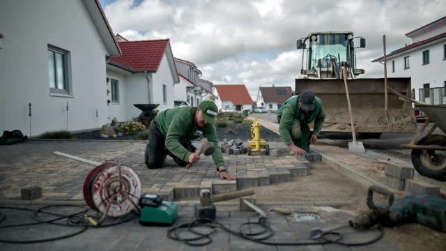 Laying of modern stone pavement in a new estate