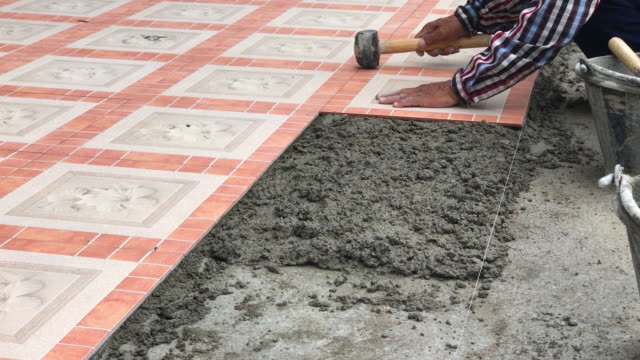 Laying tiles on the building site