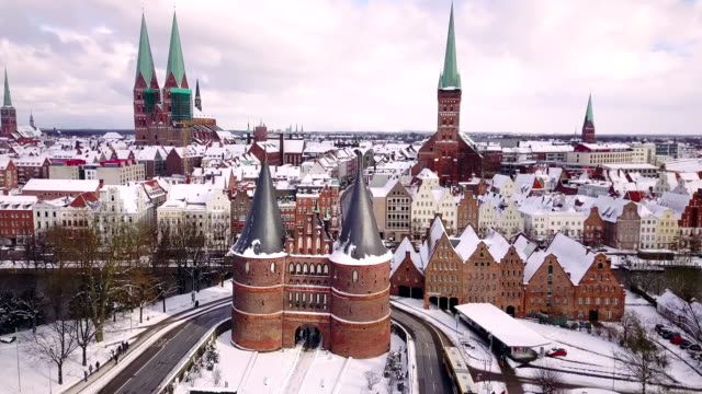 lübeck holstentor aerial view - lübeck stock-videos und b-roll-filmmaterial