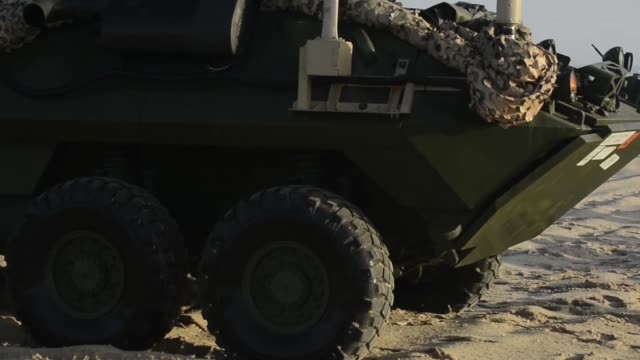 lcacs from the uss iwo jima provide transportation to marines from battalion landing team, 2nd battalion, 6th marine regiment, 26th marine... - ホバークラフト点の映像素材/bロール