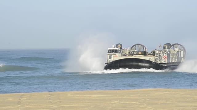 lcacs from the uss iwo jima provide transportation to marines from battalion landing team 2nd battalion 6th marine regiment 26th marine expeditionary... - hovercraft stock videos & royalty-free footage