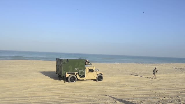LCACs from the USS Iwo Jima provide transportation to Marines from Battalion Landing Team 2nd Battalion 6th Marine Regiment 26th Marine Expeditionary...