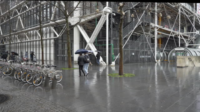 le centre pompidou in the pouring rain during winter. - unknown gender stock videos & royalty-free footage
