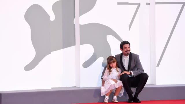 venice italy september 04 lea favino and pierfrancesco favino walk the red carpet ahead of the movie padrenostro at the 77th venice film festival at... - gif stock videos & royalty-free footage