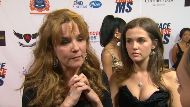 vídeos de stock, filmes e b-roll de lea thompson on being a part of the night and supporting race to erase ms if she watched the royal wedding and what she thought at the the 18th... - lea thompson