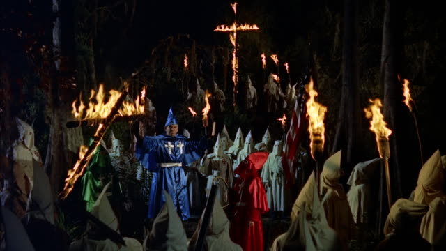 ms leader and  large ku klux klan men gather in  woods with  burning crosses and torches - ku klux klan stock videos and b-roll footage