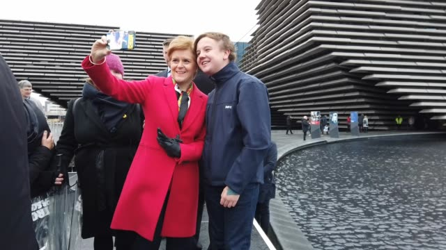 leader and scottish first minister nicola sturgeon takes selfies with newly-elected snp mps and supporters after a photocall in front of the v & a... - nicola sturgeon stock videos & royalty-free footage
