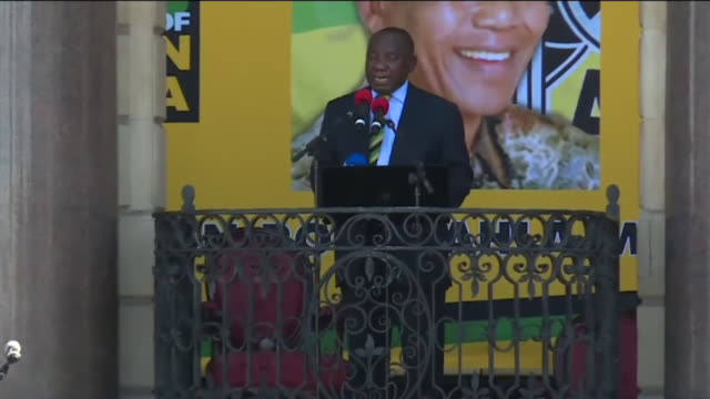 ANC leader Cyril Ramaphosa praising Nelson Mandela at a rally in Cape Town South Africa and that he plans to continue his legacy in the fight against...