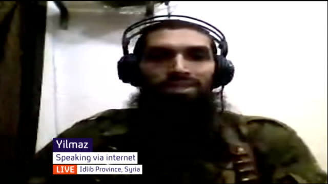 isis leader declares 'caliphate' across area of iraq and syria england london gir int yilmaz and tauqir sharif both speaking via internet from idlib... - isil conflict stock videos & royalty-free footage