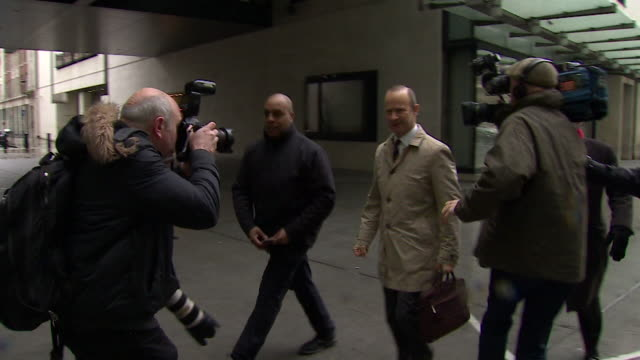 ukip leader henry bolton entering bbc broadcasting house whilst being questioned by reporters - bbc stock videos & royalty-free footage