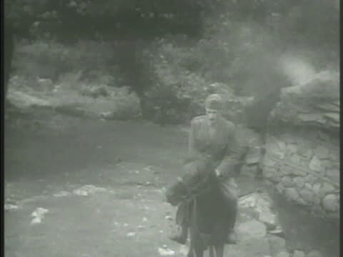leader markos vafiadis riding horse into camp dismounting vs vafiadis shaking hands w/ greek officers cu vafiadis talking ws vafiadis officers... - 1906 stock videos and b-roll footage
