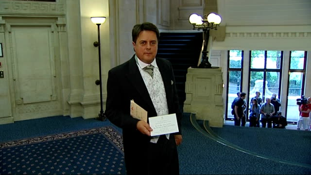 bnp leader nick griffin arrival at millbank griffin as takes royal garden party invitation out of envelope / high angle back view of griffin in... - human back stock videos & royalty-free footage