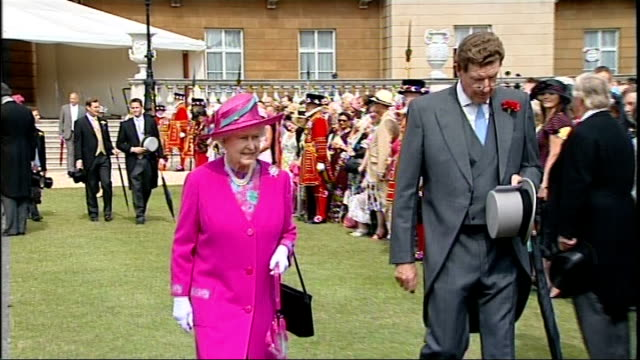 BNP Leader Nick Griffin banned from Buckingham Palace garden party LIB / 1472009 EXT Queen Elizabeth II along at garden party Guests mingling