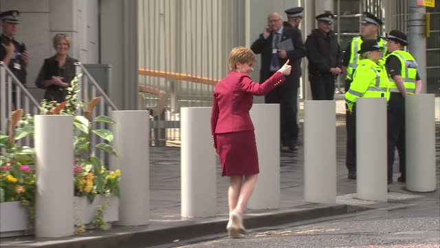 Leader Nicola Sturgeon watched Riding parade outside the Scottish Parliament building following the opening of the fifth session of the Scottish...