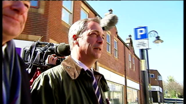 stockvideo's en b-roll-footage met ukip leader nigel farage admits tax haven mistake t30041353 / tx south shields ext farage along high street as campaigning - tyne and wear