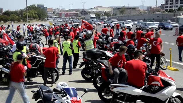 "leader of the nationalist movement party devlet bahceli and turkish professional motorcycle racer kenan sofuoglu arrive to take part in ""democracy... - patriotism stock videos & royalty-free footage"