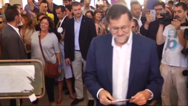leader of the popular party and spain's caretaker prime minister and party candidate mariano rajoy casts his ballot at the bernadette college polling... - 2016 stock videos & royalty-free footage