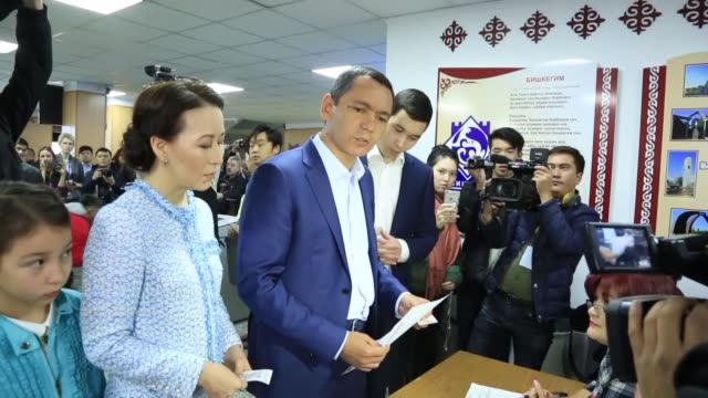 Leader of the Republic Party and presidential candidate Omurbek Babanov casts his ballot in the presidential election at a polling station in Bishkek...