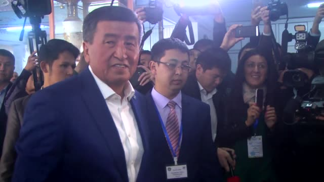Leader of the Social Democratic Party of Kyrgyzstan and presidential candidate Sooronbay Jeenbekov casts his ballot in the presidential election at a...