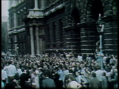 leaders appear on radio phone in 1970 edward heath standing outside number 10 on winning 1970 general election with chants of 'we want ted' from... - edward heath stock-videos und b-roll-filmmaterial