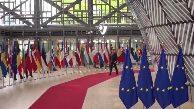 vídeos de stock e filmes b-roll de leaders arrive at a european summit in brussels where they seek a candidate for the eu's top job with all to play for after brussels political... - uniforme