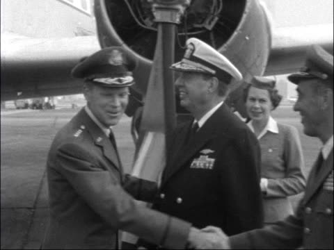 NATO leaders arrive in London for Atlantic Congress ENGLAND London London Airport EXT General Norstad off plane in uniform / PaulHenri Spaak greets...
