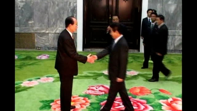 leaders of north and south korea hold talks; via aptn int roh moo-hyun into room and shakes hands with vice-president, kim yong nam photographers... - roh moo hyun stock videos & royalty-free footage