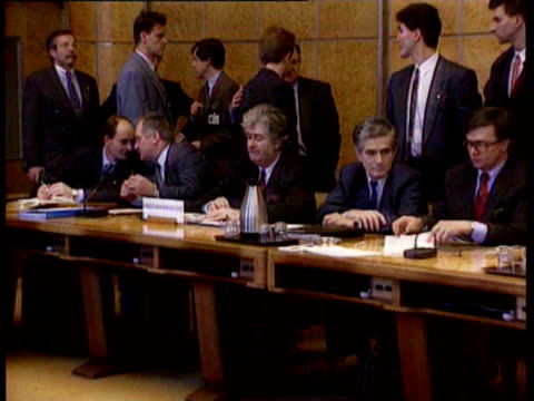 leaders of the warring factions in bosnia meet in geneva for peace talks / ext pro-izetbegovic supporters demonstrating outside united nations... - radovan karadzic stock videos & royalty-free footage