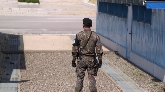 Leaders prepare for historic summit meeting SOUTH KOREA / NORTH KOREA BORDER Panmunjom EXT Soldiers and huts in the Demilitarized Zone between North...