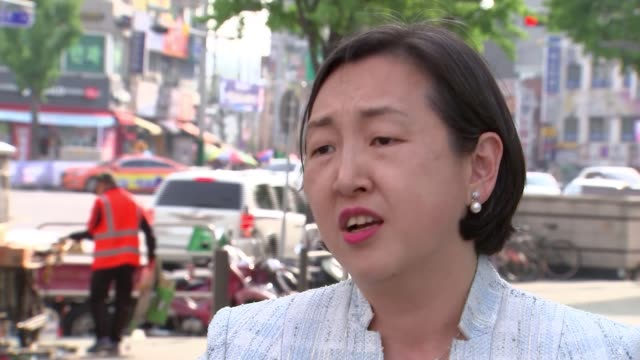leaders prepare for historic summit meeting south korea seoul ext various of ihn ji leon talking with people on the street ihn ji leon interview sot... - south korea stock videos and b-roll footage
