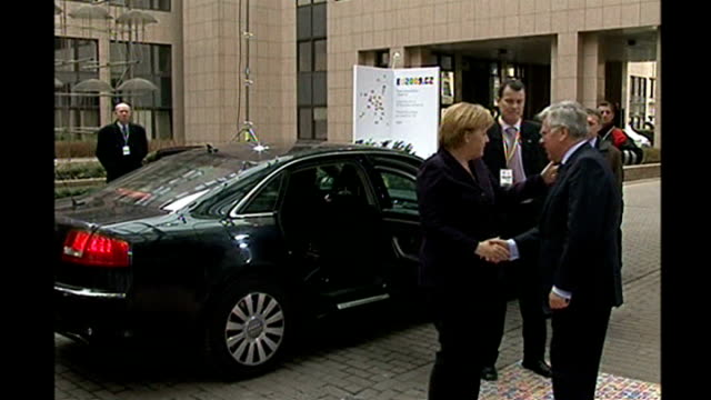 EU leaders reject financial rescue package for ailing East European economies BELGIUM Brussels EXT Angela Merkel out of car on arrival for emergency...
