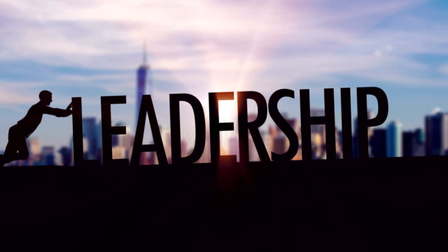 Leadership  - Businessman silhouette pushing thematic title
