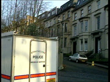 leading crown prosecutor, marshall stormonth, murdered; scotland: glasgow bv strathclyde mobile police office parked tilt up to exterior of flat... - murder victim stock videos & royalty-free footage
