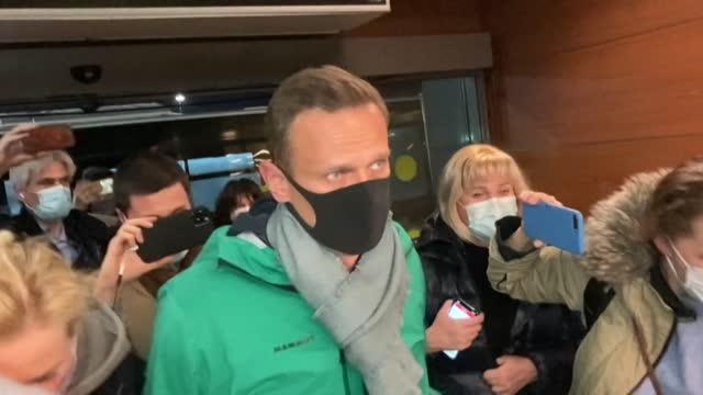 leading kremlin critic alexei navalny is seen at moscow's sheremetyevo airport minutes before being detained by police after returning to russia from... - critic stock videos & royalty-free footage