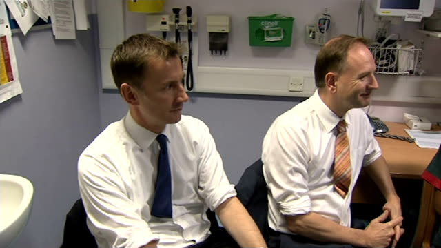 leading think tank attacks government's nhs reforms lib jeremy hunt mp and simon stevens sat in office during hospital visit hunt - 政治家 ジェレミー ハント点の映像素材/bロール