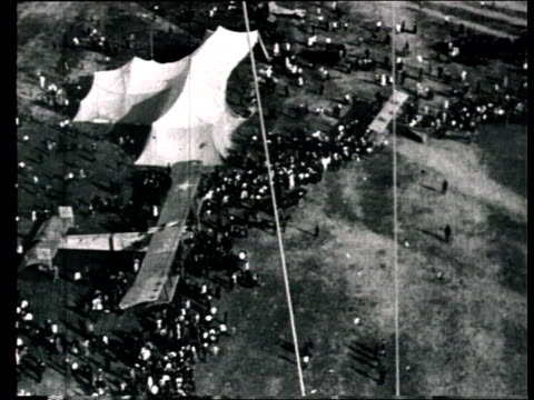 1925 B/W HA WS POV Leaflets dropping from balloon to crowd standing around aeroplane on ground below/ Moscow, Russia