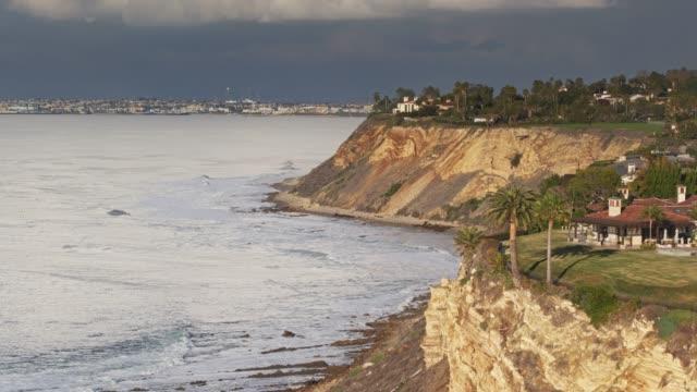 leafy neighborhood in palos verdes with la visible along coastline - aerial - palos verdes stock videos & royalty-free footage