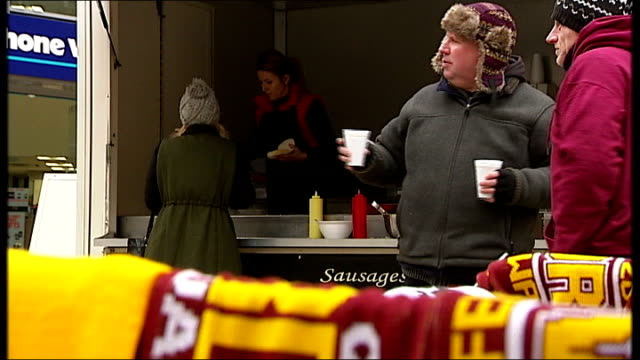bradford city v swansea city england west yorkshire bradford ext people along street past stall selling bradford city afc merchandise people at fast... - neckwear stock videos and b-roll footage