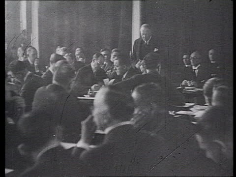 league of nations at conference, committee for disarmament meetings, diplomats walking through corridor, soviet delegation leaving building /... - 1935 stock-videos und b-roll-filmmaterial