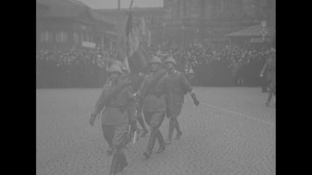 league of nations police force in formation in streets of the saar basin during league occupation / vs british italian troops march in city streets... - paramount building stock videos and b-roll footage
