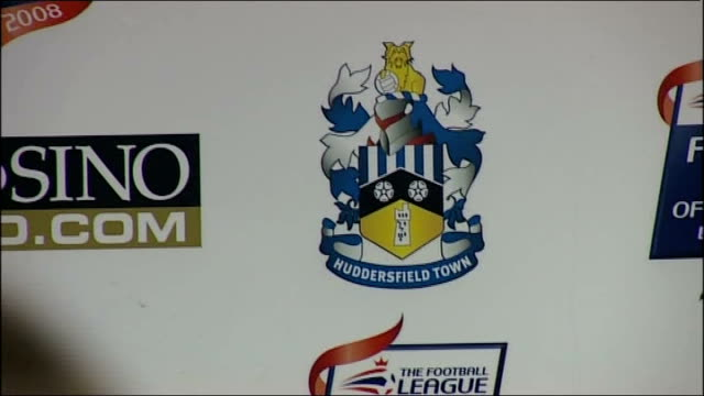 lee clark appointed as manager of huddersfield town; close-up of huddersfield town fc crest clark talking to unidentified man close-up of clark's... - huddersfield town football club stock videos & royalty-free footage
