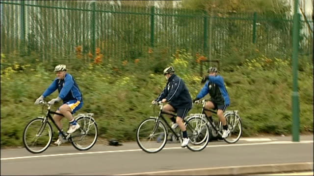 vídeos y material grabado en eventos de stock de shrewsbury town squad on bikes more of players cycling round shrewsbury squad cycle next to prostar stadium good shots of prostar stadium players and... - shrewsbury