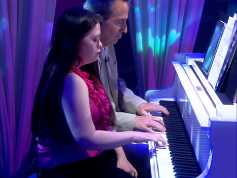 leah stodden leah stodden, who has down syndrome, performs a song on the piano leah's younger sister lindsay, wrote an inspiring letter about her... - chromosome stock videos & royalty-free footage