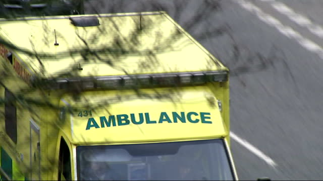 vídeos de stock e filmes b-roll de leaked memo suggests ambulance waiting times could double; england: ext ambulance along road with siren sounding oxfordshire: bicester: professor... - oxfordshire
