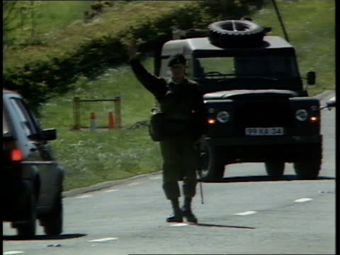 leaked security documents row northern ireland leaked security documents row itn lib co fermanagh border ms 2 soldiers by landrover roadblock as one... - 北アイルランド点の映像素材/bロール