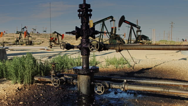 leaking oil pumpjack - oil spill stock videos & royalty-free footage